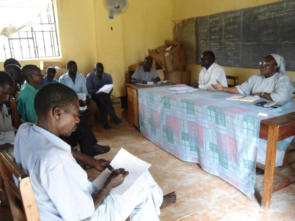 Sister Clare and teachers  Mr Otiti Patrick and Mr Otim Cyprian interacting with community leaders