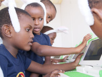 Primary school children testing a literacy programme at eLearning Africa