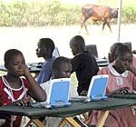 Kids using the solar-powered laptops, © Intel